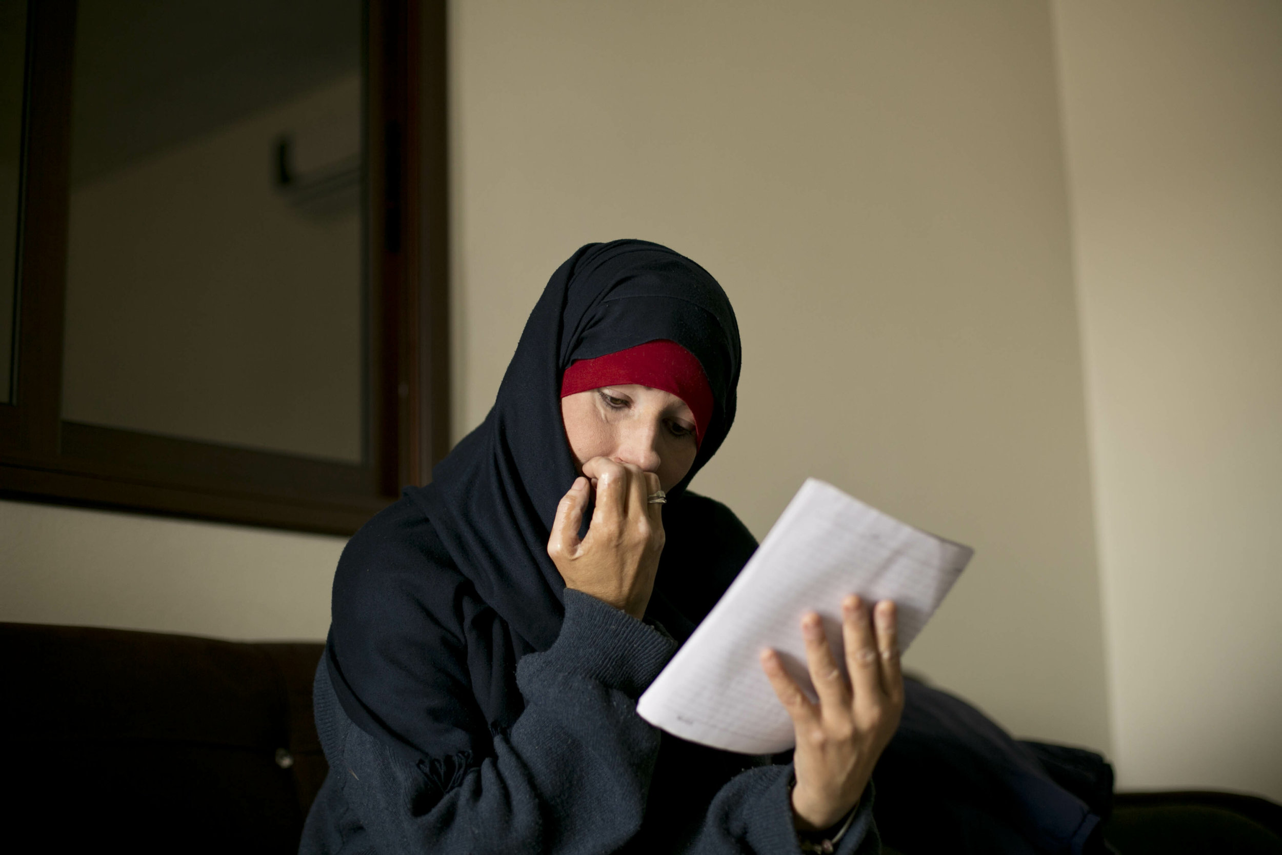 Kimberly Gwen Polman, a Canadian national, reads a letter she wrote to her countrymen at camp Roj in Syria on April 3, 2019. Polman followed her husband to Raqqa, Syria, the Islamic State group's capital at the time. (AP Photo/Maya Alleruzzo)