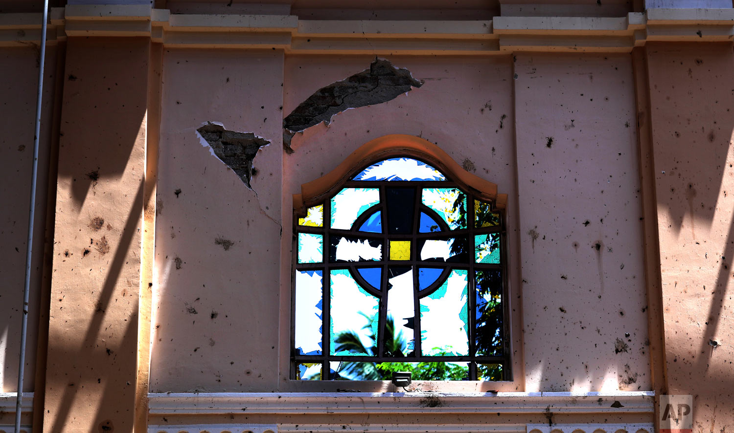 A stained-glass window stands broken at Sebastian's Church, in Negombo, Sri Lanka, April 25, 2019. (AP Photo/Manish Swarup)