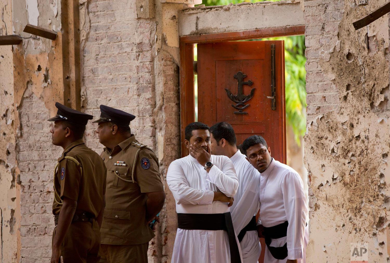 Clergymen visit the scene of a suicide bombing at St. Sebastian Church in Negombo, Sri Lanka, April 22, 2019. (AP Photo/Gemunu Amarasinghe)