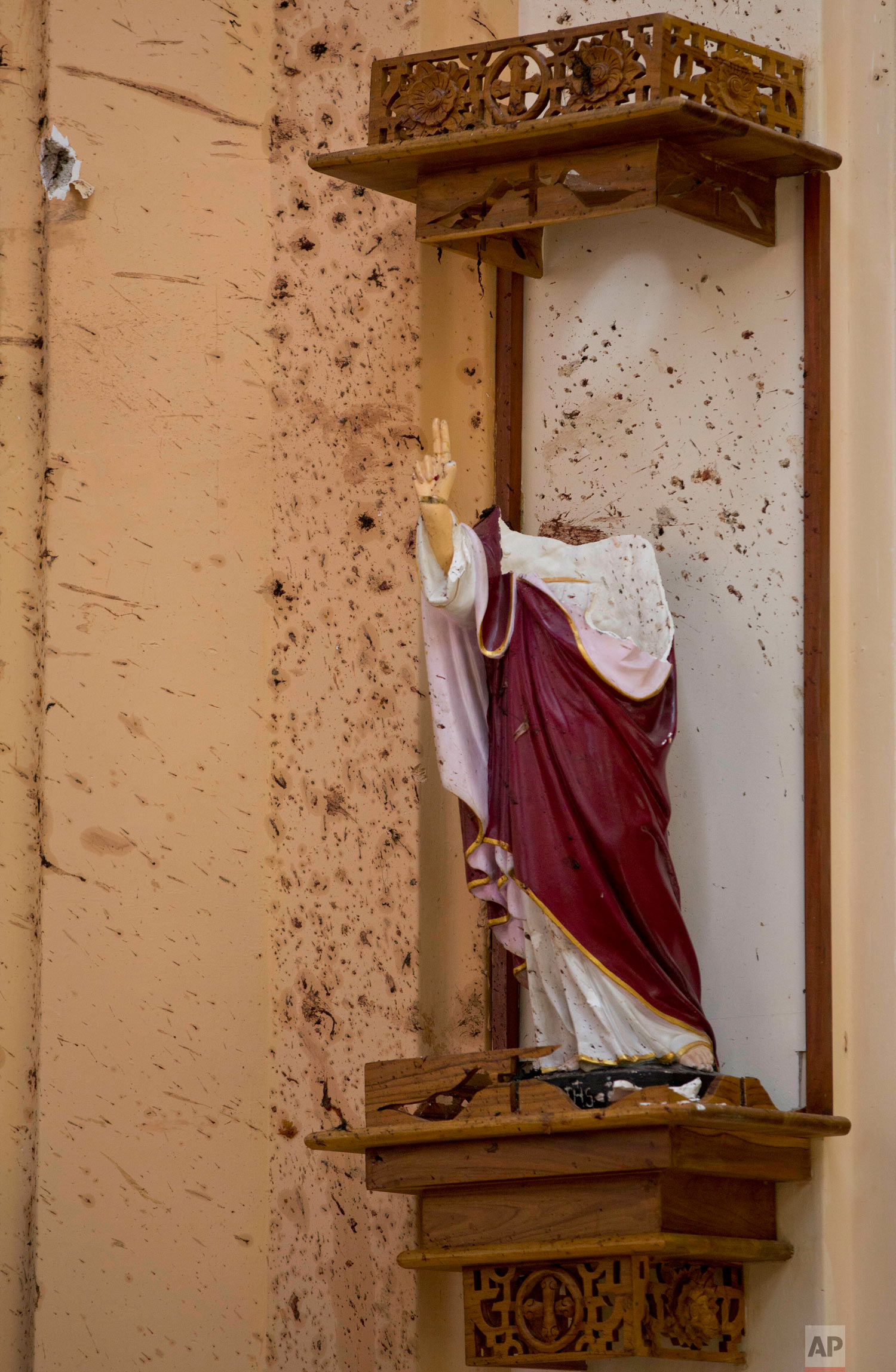 A part of a damaged religious shrine stays intact at the scene of a suicide bombing at St. Sebastian Church in Negombo, Sri Lanka, April 22, 2019. (AP Photo/Gemunu Amarasinghe)