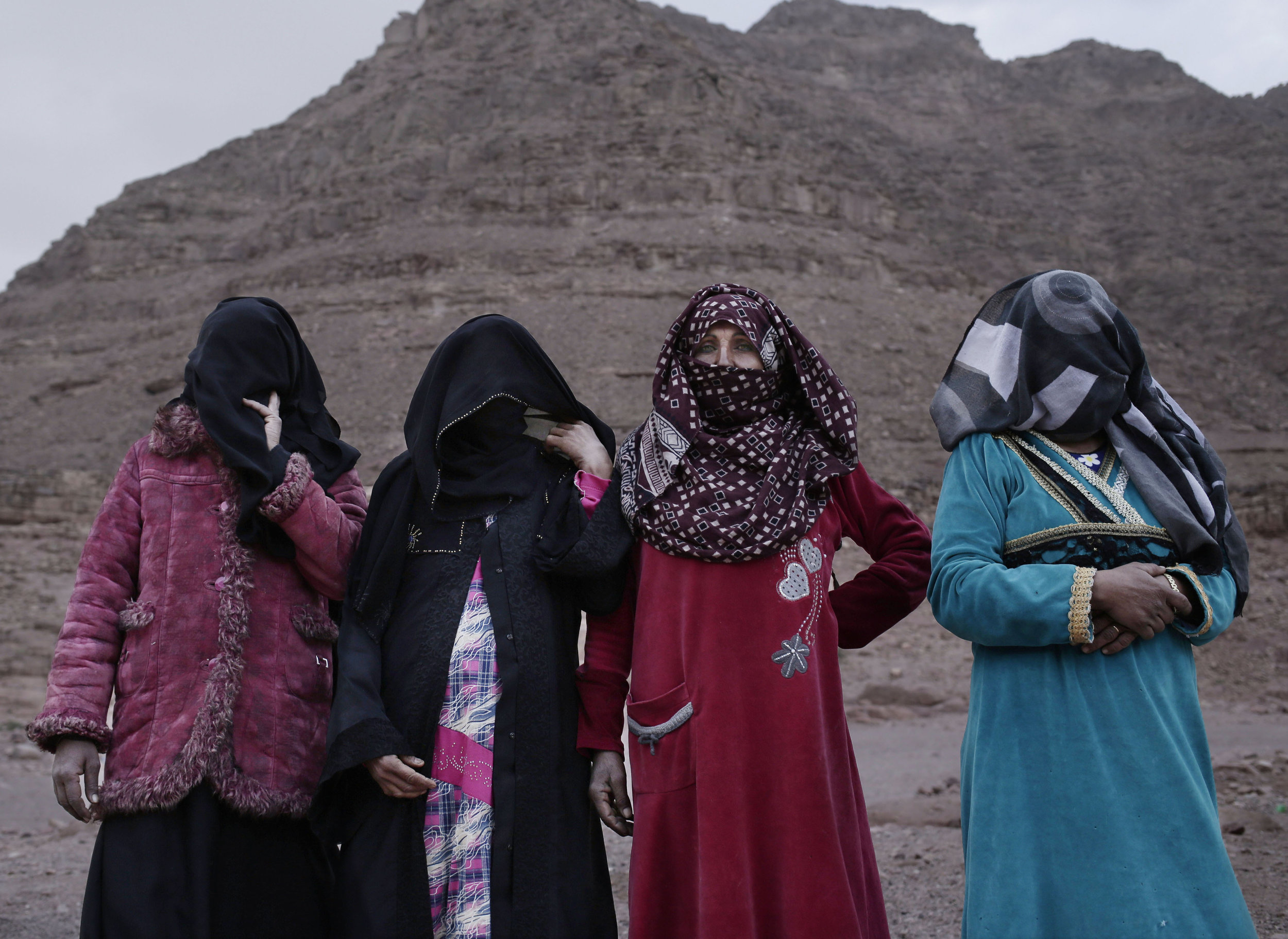 The first female Bedouin guides, from right, Selima, Umm Yasser, Umm Soliman, and Aicha, pose for a photograph in Wadi Sahw, Abu Zenima, in South Sinai, Egypt. on March 30, 2019. (AP Photo/Nariman El-Mofty)