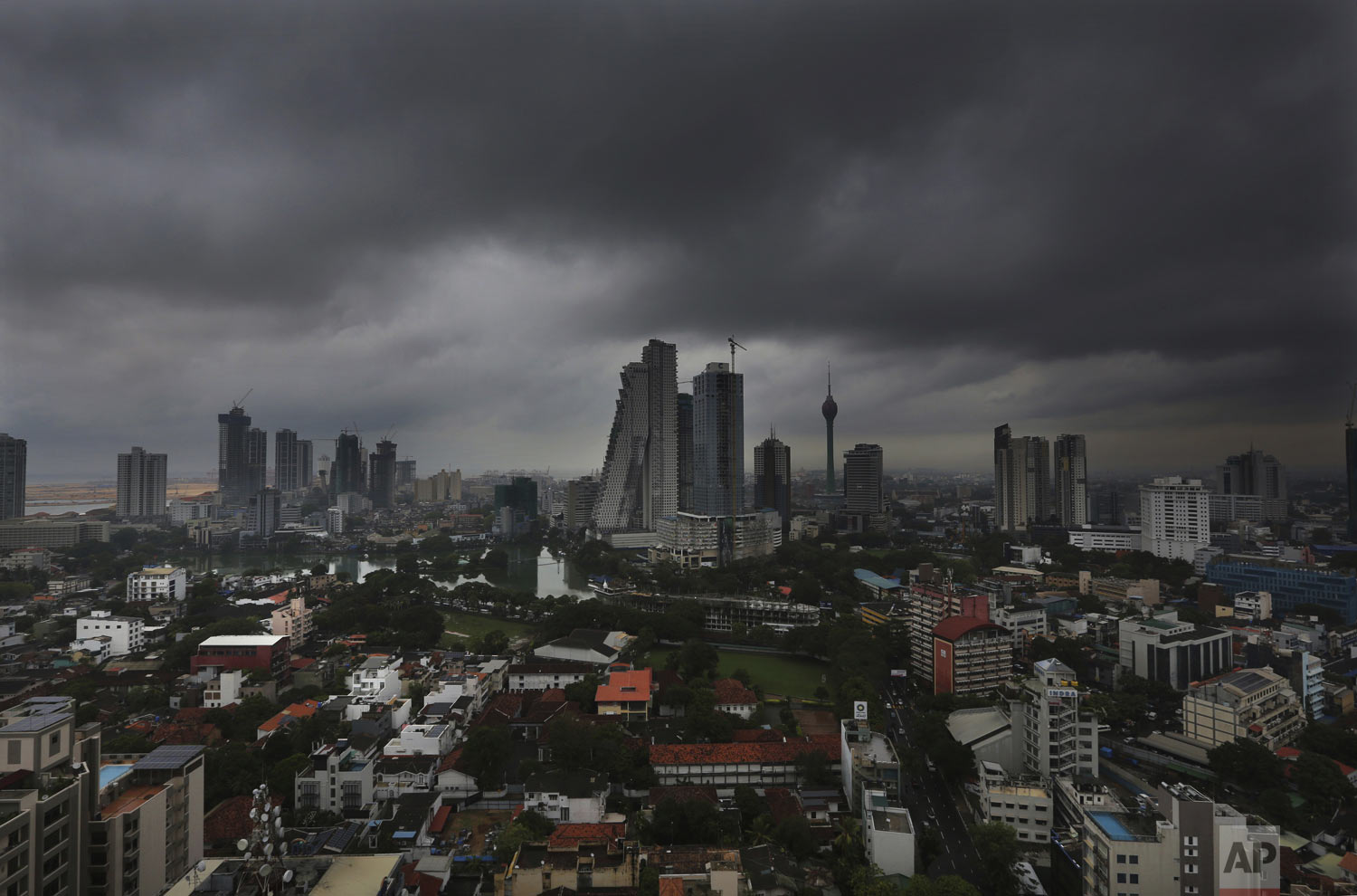 "Dark clouds from a thunderstorm pass over Colombo, Sri Lanka, Tuesday, April 30, 2019. On Friday, the India Meteorological Department said the ""extremely severe"" cyclone Fani in the Bay of Bengal hit the coastal state of Odisha around 8 a.m., with weather impacted across the Asian subcontinent. (AP Photo/Manish Swarup)"