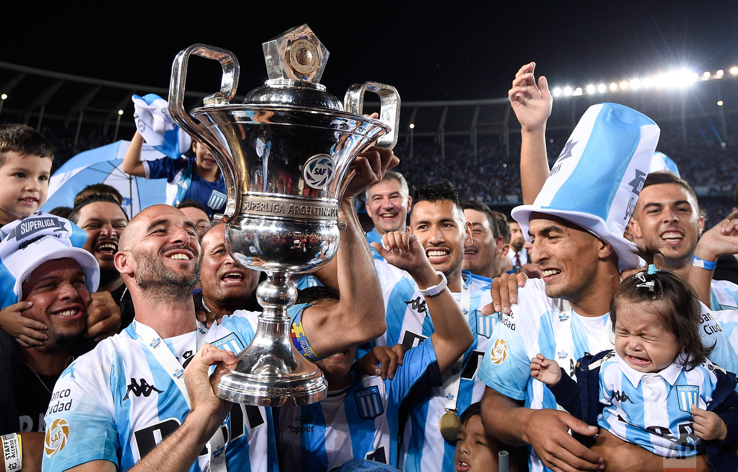Racing Club players celebrate their national league trophy after defeating Defensa y Justicia in Buenos Aires, Argentina, April 7, 2019. (AP Photo/Gustavo Garello)