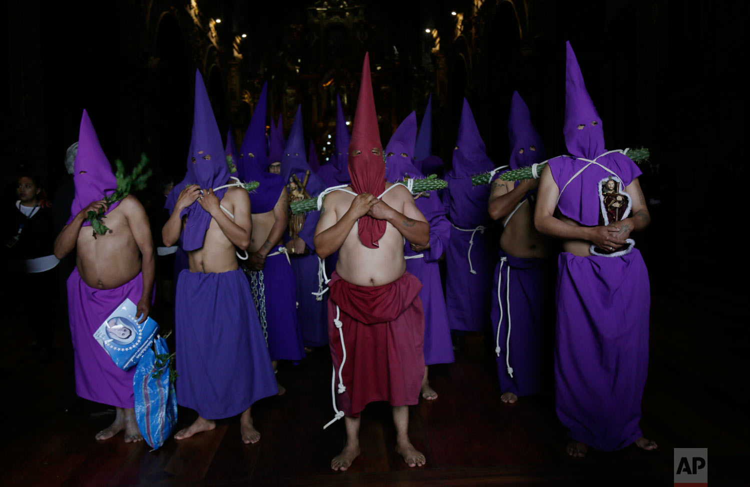 Hooded and barefoot penitents leave San Francisco church during the Jesus del Gran Poder procession on Good Friday in Quito, Ecuador, April 19, 2019. (AP Photo/Dolores Ochoa)