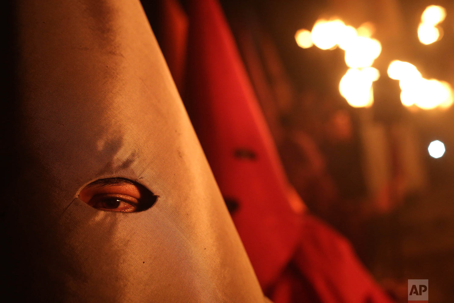 Hooded penitents walk during the Procession of Torches, a Holy Week procession in Goias, Brazil, earl, April 18, 2019. (AP Photo/Eraldo Peres)
