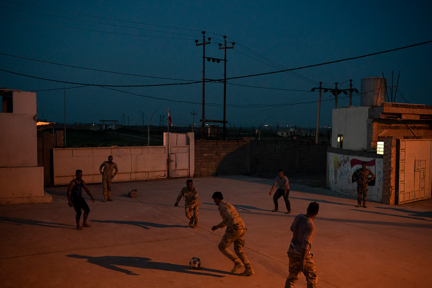 In this April 9, 2019 photo, Iraqi army 20th division soldiers play soccer in a military base in Badoush, Iraq. (AP Photo/Felipe Dana)