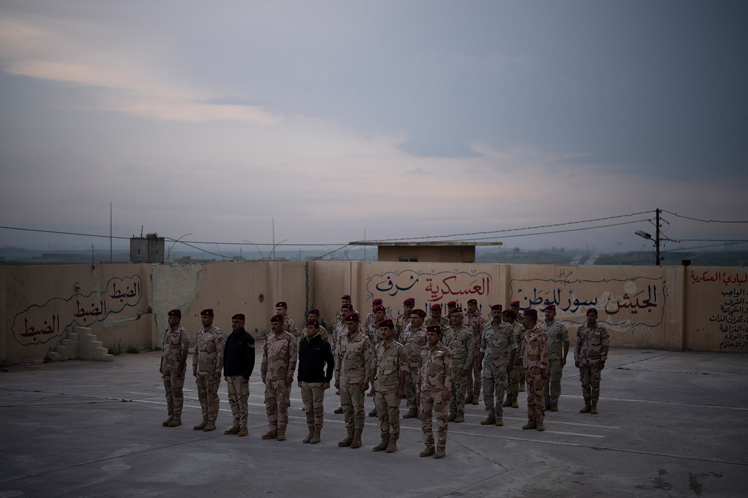 In this April 10, 2019 photo, Iraqi army 20th division soldiers stand in formation in a military base in Badoush, Iraq. (AP Photo/Felipe Dana)