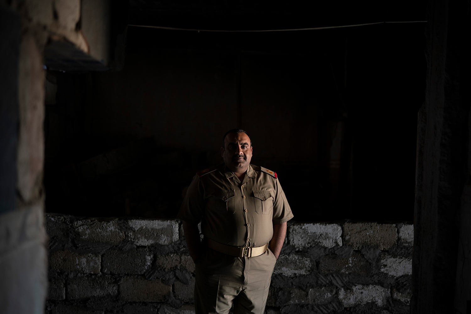 In this April 9, 2019 photo, Iraqi army 20th division Major Khalid Abdullah poses for a portrait in Badoush, Iraq. His battalion is permanently based in the area as a peace keeping force. They man checkpoints and carry out raids to identify and arrest remaining Islamic State militants. (AP Photo/Felipe Dana)