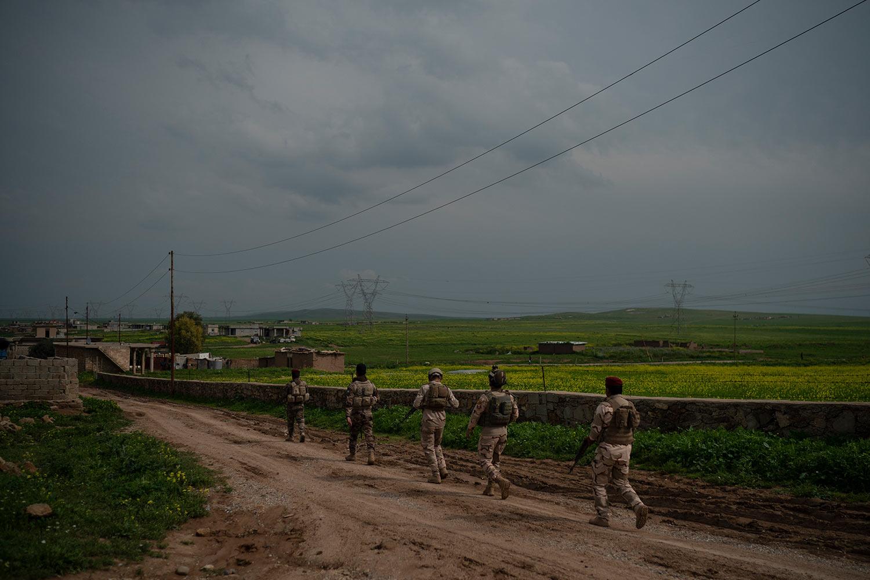 In this April 3, 2019 photo, Iraqi army 20th division soldiers patrol a village in Badoush area, Iraq. (AP Photo/Felipe Dana)