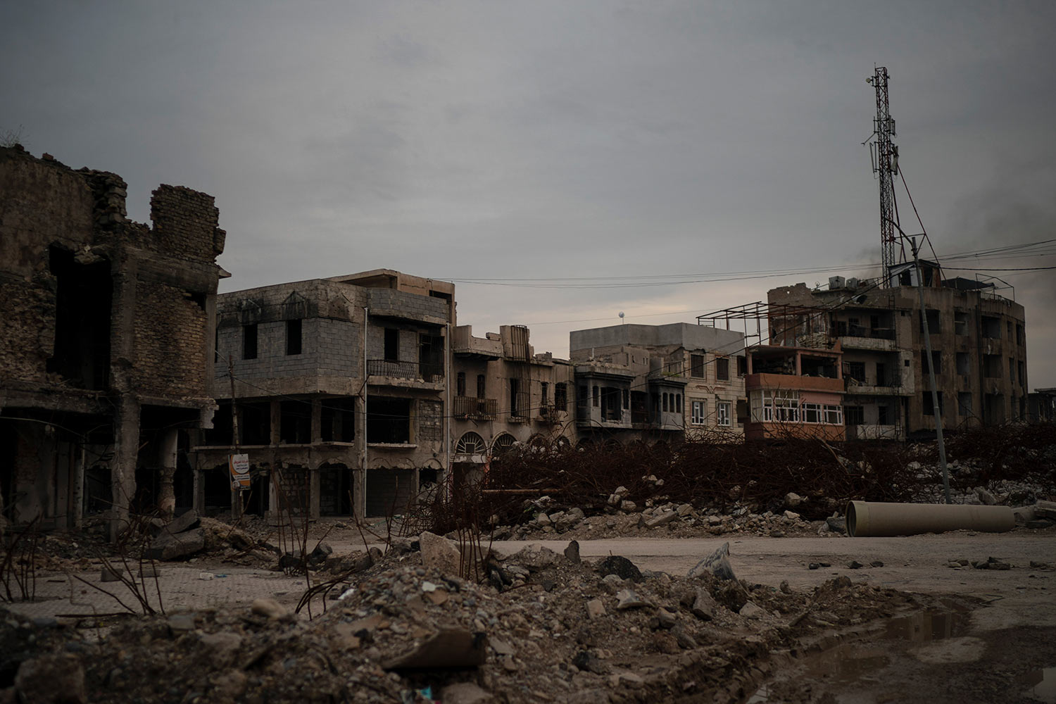 In this April 14, 2019 photo, debris from buildings destroyed during the war sit on a street in Mosul, Iraq. (AP Photo/Felipe Dana)