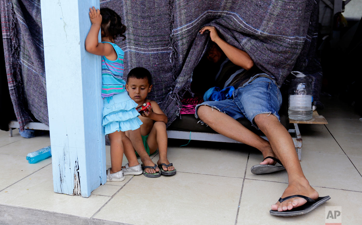 Migrants seeking asylum in the United States wait at a shelter in Reynosa, Mexico, May 1, 2019. (AP Photo/Eric Gay)
