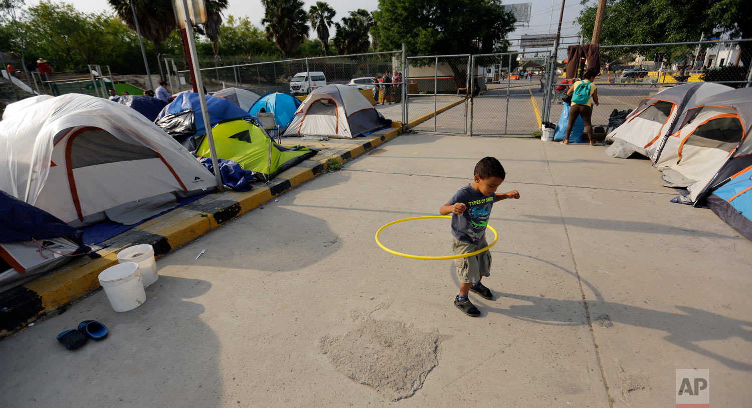 William Linares, 5, who is traveling with his mother Suanny Gomez from Honduras and seeking asylum in the United States plays in an encampment where he is living near the international bridge in Matamoros, Mexico, April 30, 2019. (AP Photo/Eric Gay)