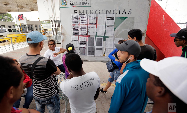 Migrants seeking asylum in the United States wait next to a list for asylum near the international bridge in Matamoros, Mexico, April 30, 2019. (AP Photo/Eric Gay)