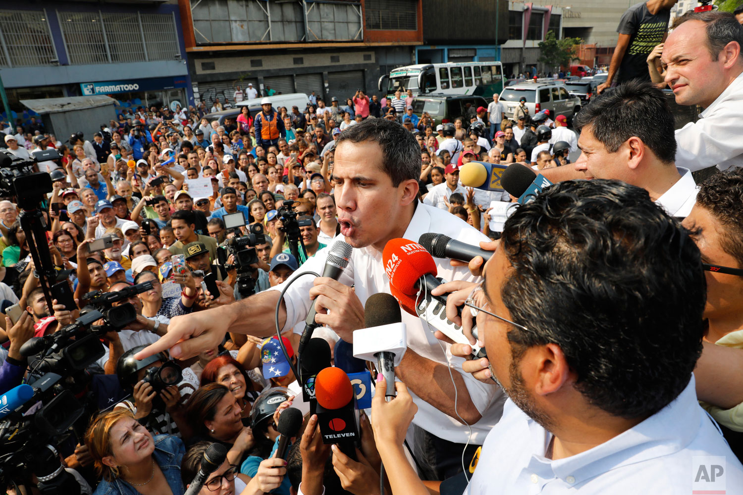 Opposition leader Juan Guaido, who has declared himself Venezuela's interim president, speaks to supporters during a rally in San Martin Caracas, Venezuela, Wednesday, April 10, 2019. (AP Photo/Ariana Cubillos)