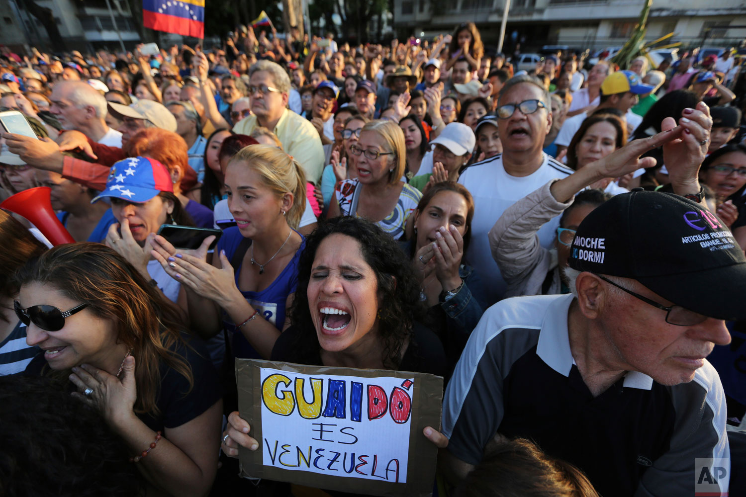 Supporters of self-proclaimed interim president Juan Guaido cheer during a rally in Caracas, Venezuela, Friday, April 5, 2019.  (AP Photo/Fernando Llano)