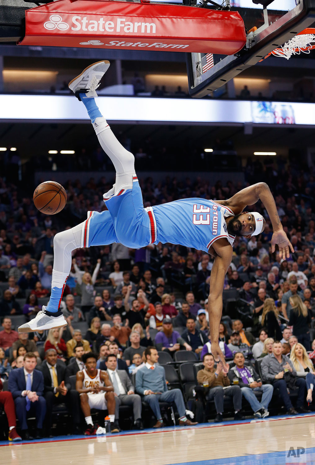 Sacramento Kings guard Corey Brewer flips through the air after scoring on a breakaway stuff during the first quarter of an NBA basketball game against the Cleveland Cavaliers Thursday, April 4, 2019, in Sacramento, Calif. (AP Photo/Rich Pedroncelli)