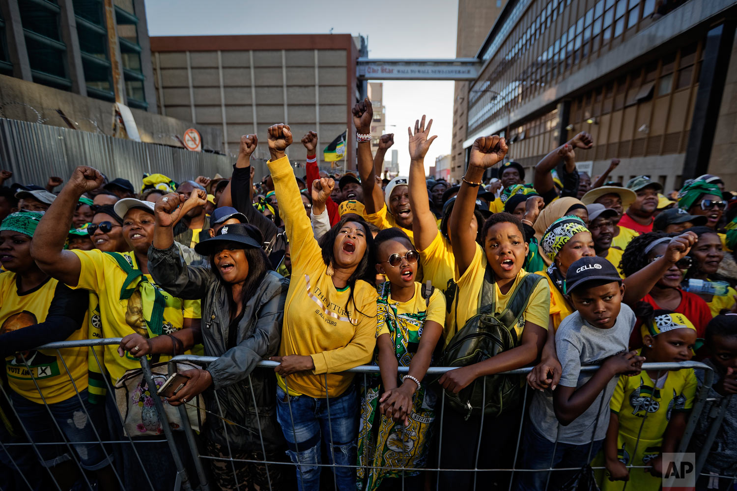 Supporters of the African National Congress (ANC) party cheer during a victory rally in downtown Johannesburg, South Africa, May 12, 2019. (AP Photo/Ben Curtis)