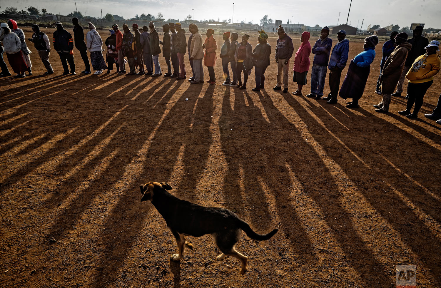 South Africans queue in the early morning sun to cast their votes in the mining settlement of Bekkersdal, west of Johannesburg, in South Africa, May 8, 2019. (AP Photo/Ben Curtis)