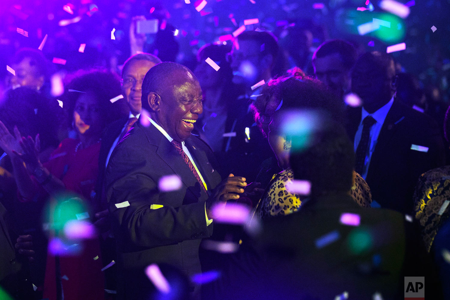 South Africa President Cyril Ramaphosa celebrates after the Independent Electoral Commission announced the final results in South Africa's general election in Pretoria, May 11, 2019. (AP Photo/Jerome Delay)