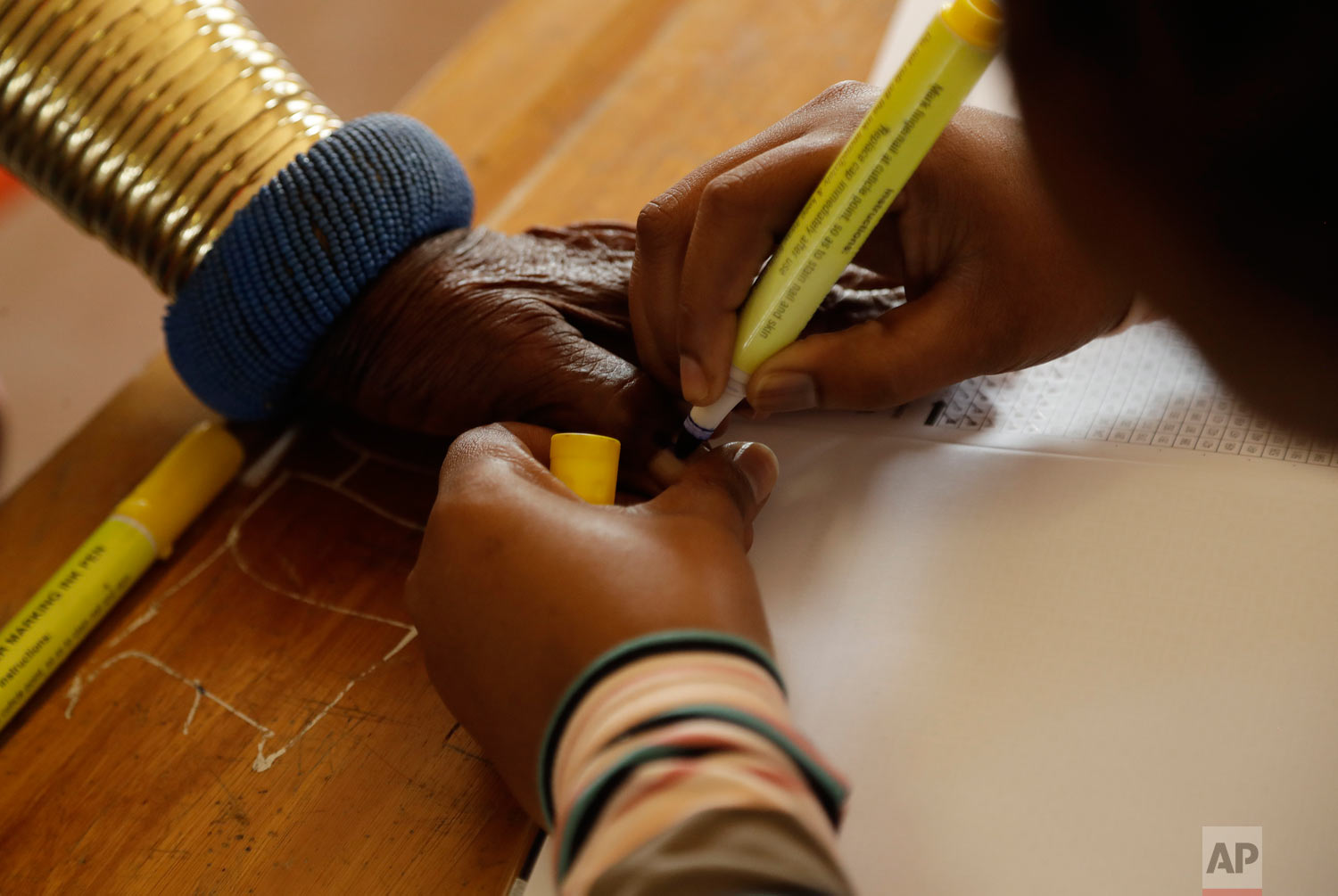 Esther Mahlangu has her thumb ink-marked before casting her vote at a polling station at KwaMhlanga in Mpumalanga, South Africa, May 8, 2019. (AP Photo/Themba Hadebe)