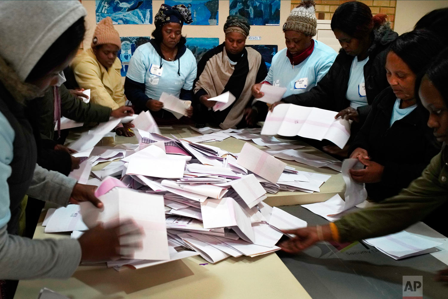Electoral commission agents start counting the votes May 8, 2019, in Johannesburg, South Africa. (AP Photo/Jerome Delay)