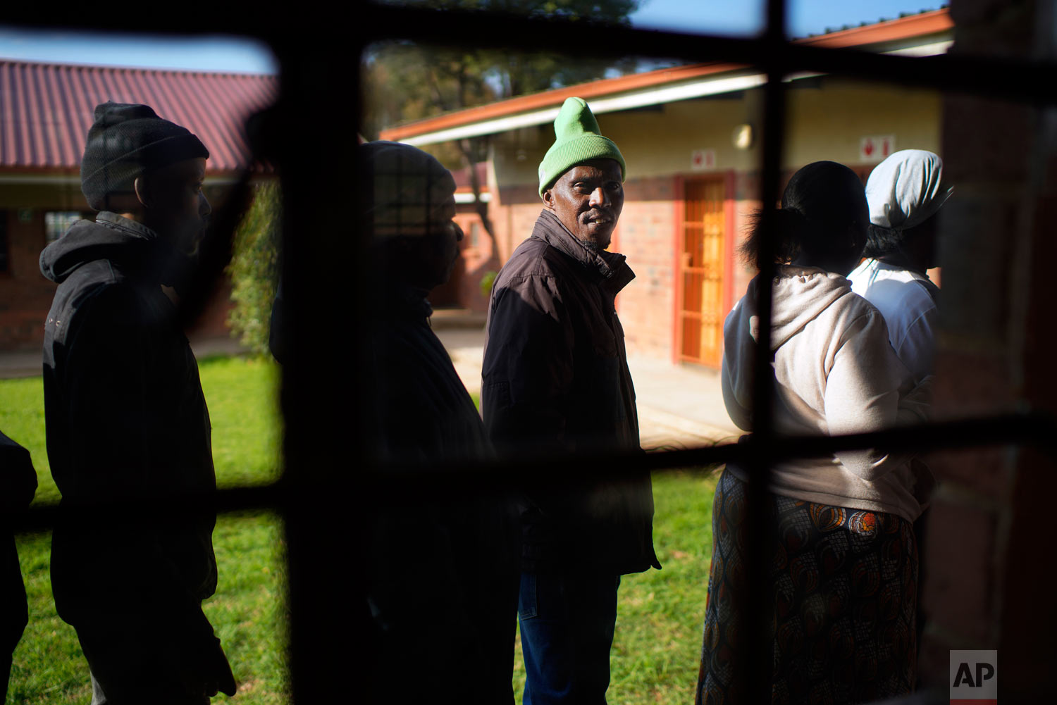 Locals line up to cast their vote May 8, 2019, general elections in Soweto, South Africa. (AP Photo/Jerome Delay)