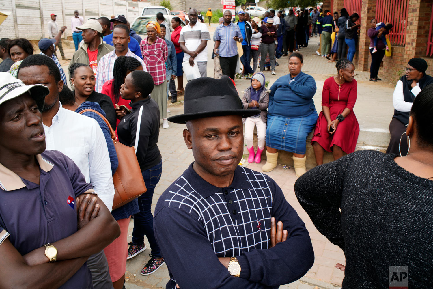 South Africans line up to cast their vote in the May 8, 2019, general elections in Diepsloot, South Africa. South (AP Photo/Jerome Delay)
