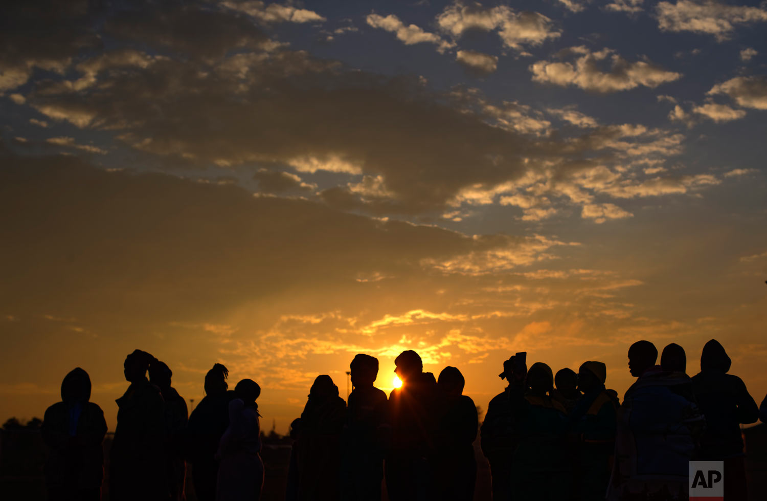 South Africans queue in the early morning cold to cast their votes in the mining settlement of Bekkersdal, west of Johannesburg, in South Africa, May 8, 2019. (AP Photo/Ben Curtis)