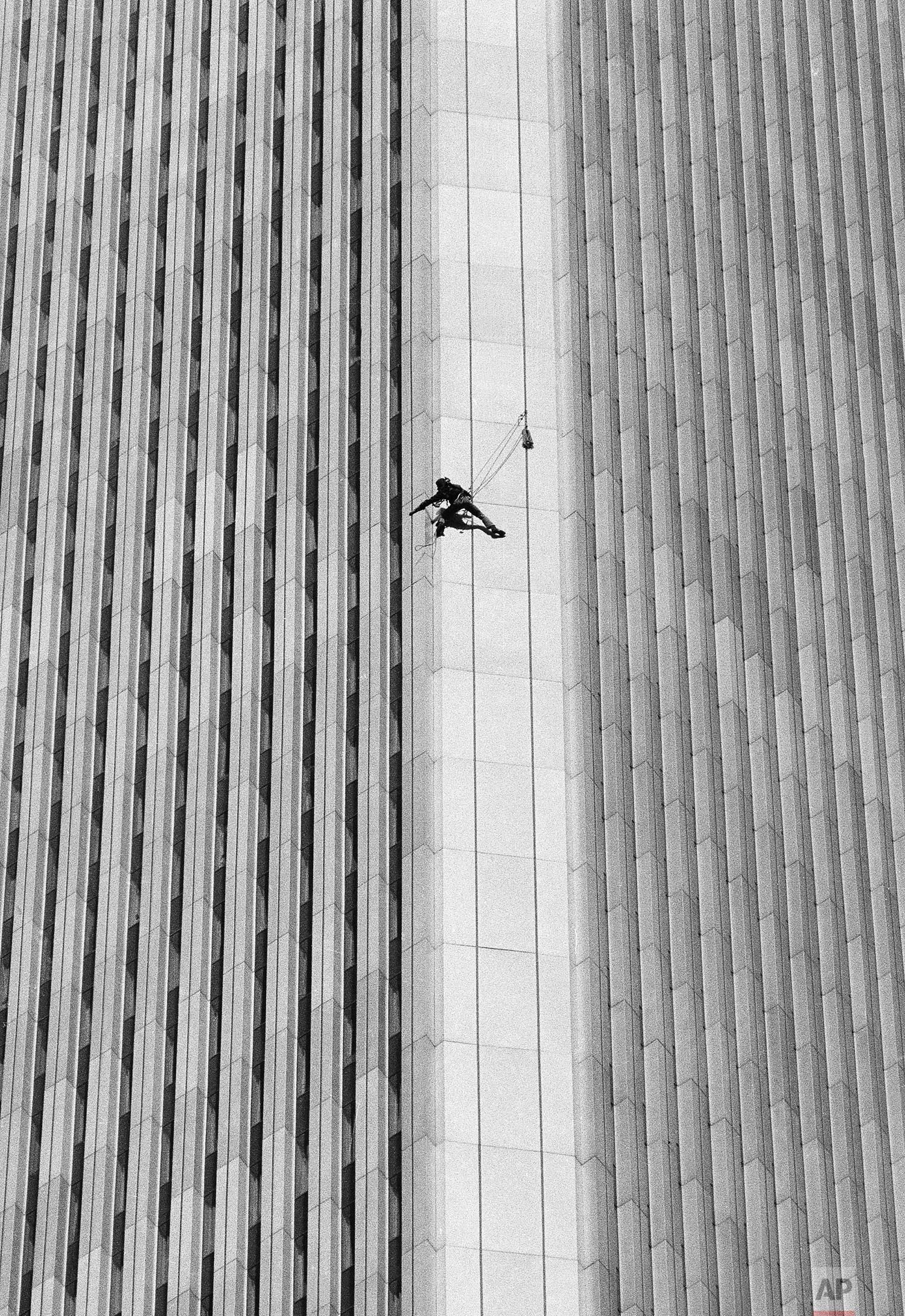 A man identified by friends as George Willig, 28, of New York, climbs the south tower of the World Trade Center in New York on Thursday, May 26, 1977. The building is 110 stories high. (AP Photo/Dave Pickoff)