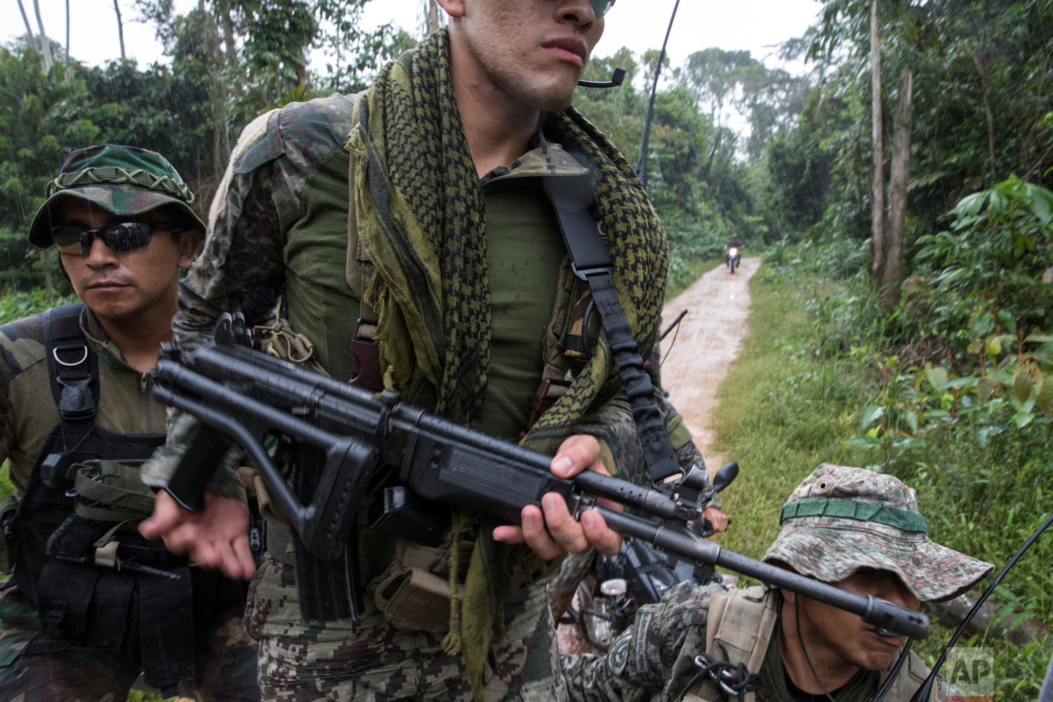 """Operation Mercury"" special forces patrol an area after the destruction of machinery used by illegal miners in the Tambopata province, one of three that make up the Madre de Dios department, March 27, 2019, in southern Peru. (AP Photo/Rodrigo Abd)"