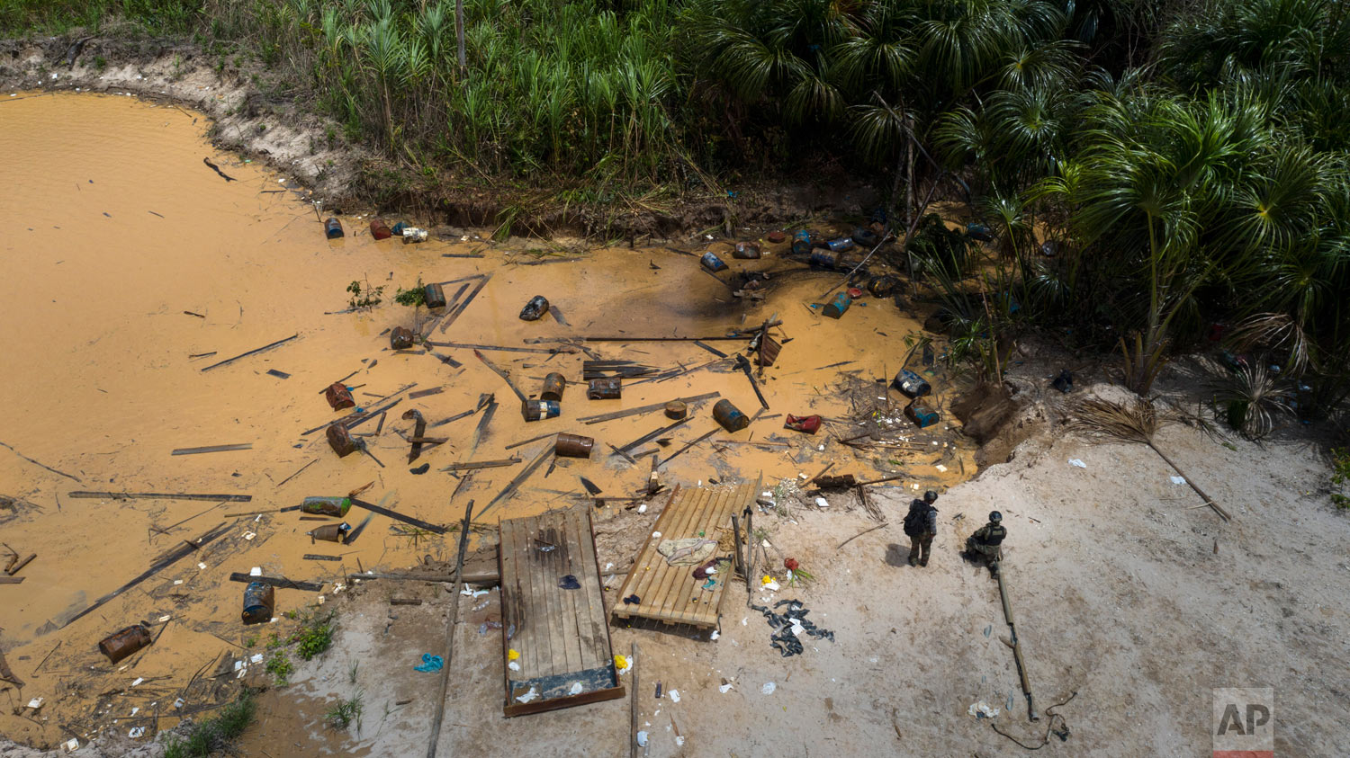 "An illegal mining camp destroyed by members of ""Operation Mercury"", is seen in this March 27, 2019, photo, in Peru's Tambopata province. ""The damage to nature here is so terrible that all the water is poisoned,"" said Maj. Gustavo Cerdeña, head of a police unit. (AP Photo/Rodrigo Abd)"