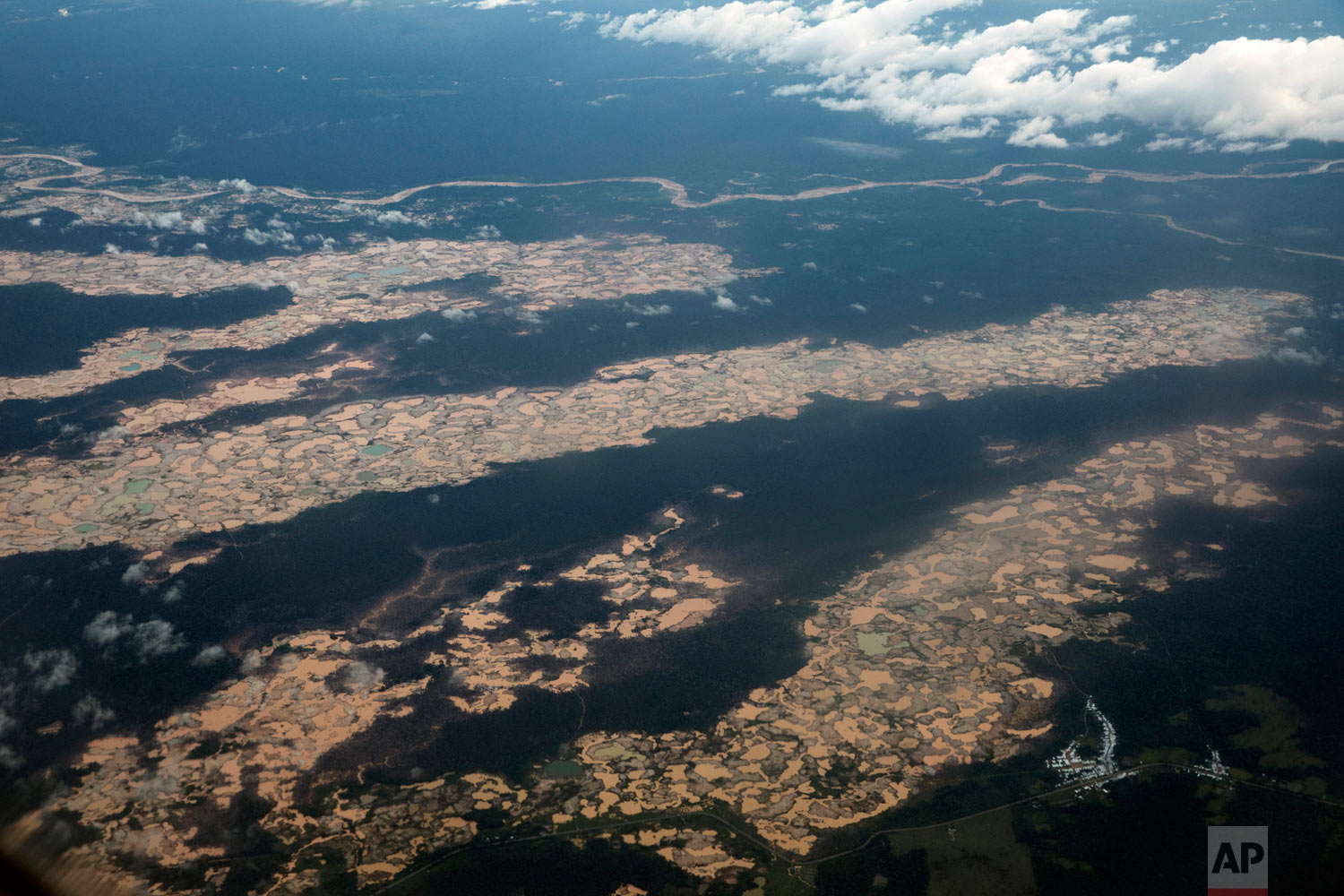 Shows an aerial view of thousands of destroyed hectares of Amazon jungle by illegal miners, March 26, 2019, in the Tambopata province, one of three that make up Peru's Madre de Dios department. (AP Photo/Rodrigo Abd)