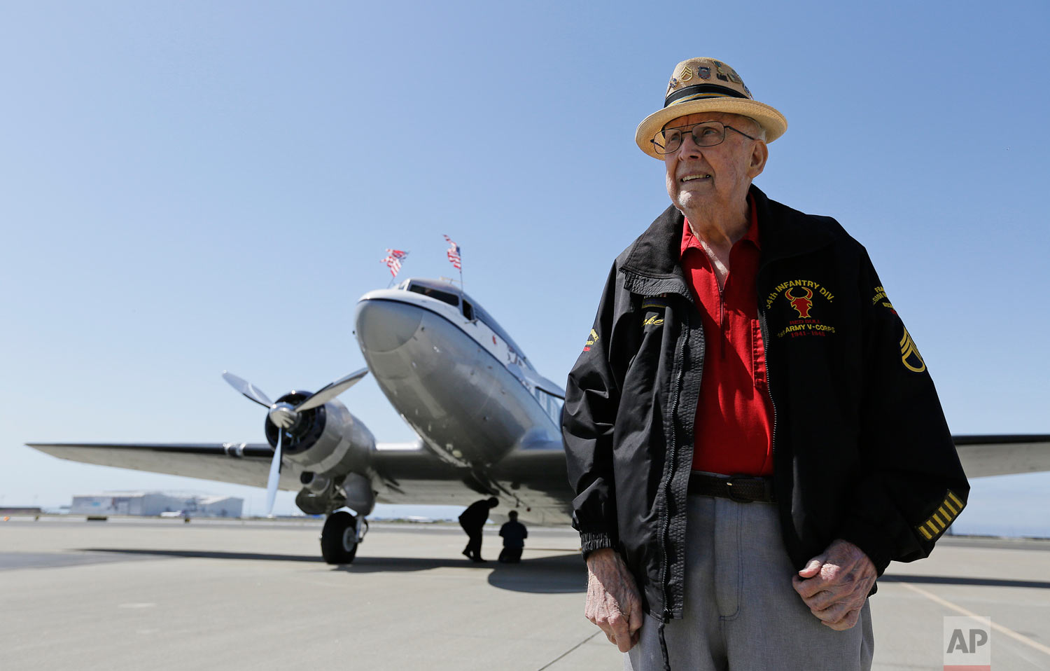 "In this photo taken April 29, 2019, D-Day veteran Jake Larson poses before going for a ride in the ""The Spirit of Benovia"" World War II-era aircraft in Oakland, Calif. Both Larson and the former C-53 Skytrooper transport plane plan to be in Normandy, France and take part in events for the 75th anniversary of D-Day. The plane takes its name after a winery in Sonoma County. (AP Photo/Eric Risberg)"