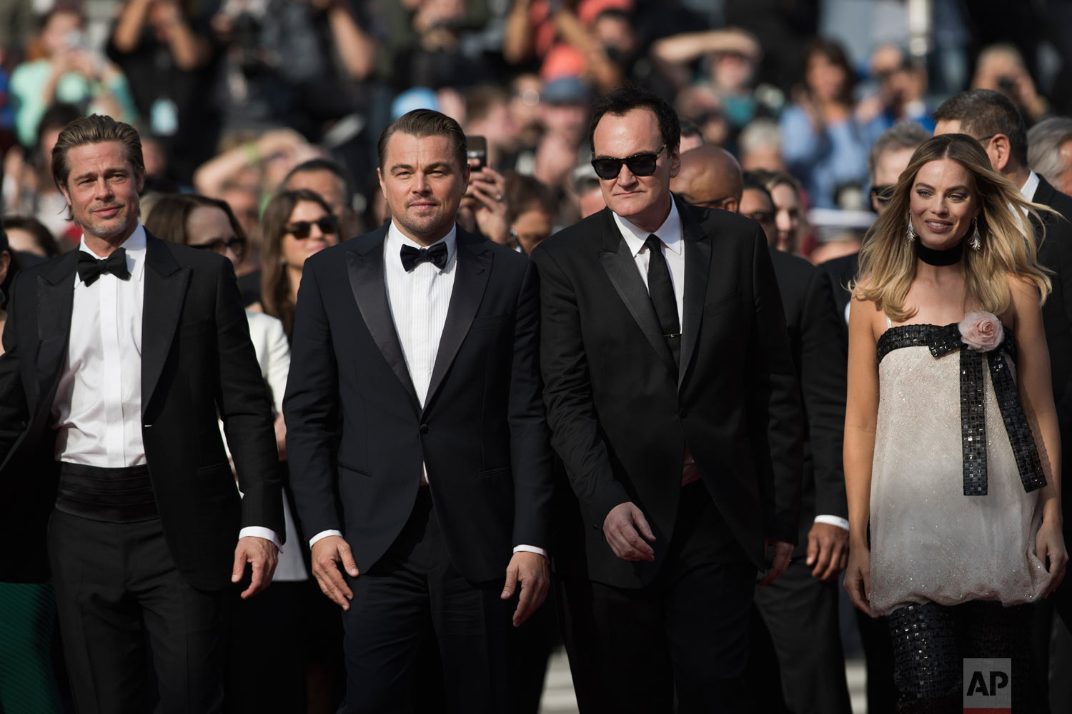 Actors Brad Pitt, from left, Leonardo DiCaprio, director Quentin Tarantino and actress Margot Robbie pose for photographers upon arrival at the premiere of the film 'Once Upon a Time in Hollywood' at the 72nd international film festival, Cannes, southern France, May 21, 2019. (AP Photo/Petros Giannakouris)