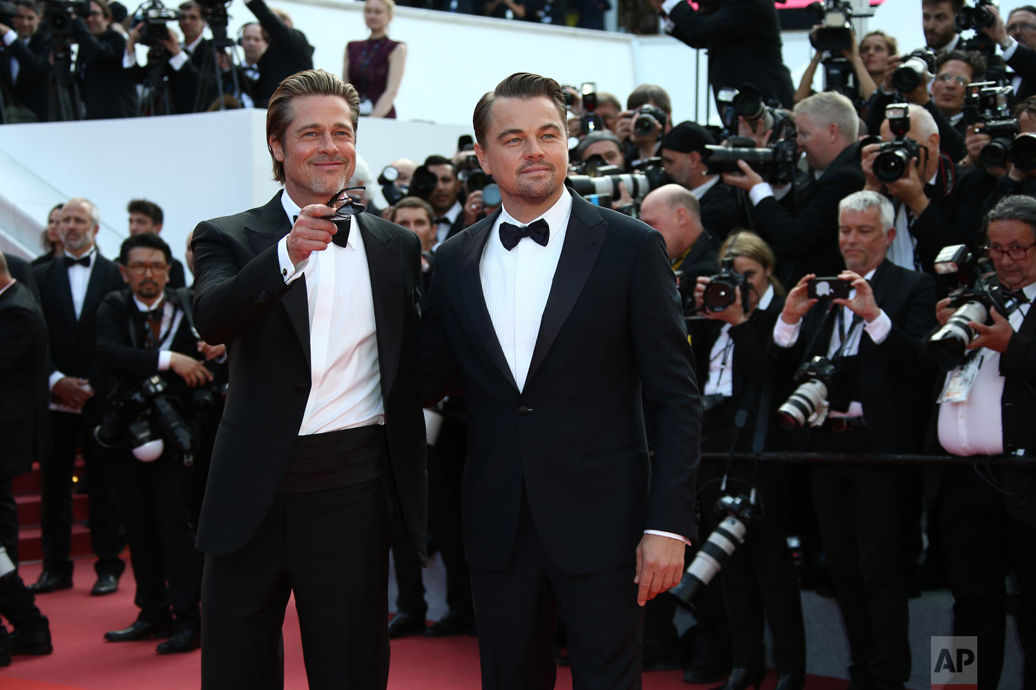 Actors Brad Pitt, left and Leonardo DiCaprio pose for photographers upon arrival at the premiere of the film 'Once Upon a Time in Hollywood' at the 72nd international film festival, Cannes, southern France, May 21, 2019. (Photo by Joel C Ryan/Invision/AP)