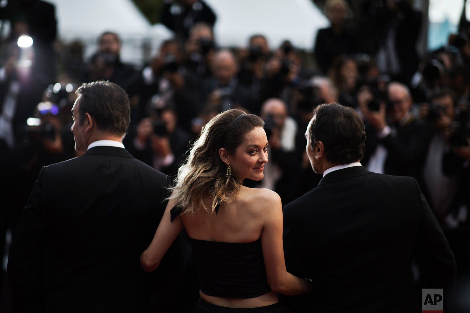 Actress Marion Cotillard, centre, poses for photographers upon arrival at the premiere of the film 'La Belle Epoque' at the 72nd international film festival, Cannes, southern France, May 20, 2019. (AP Photo/Petros Giannakouris)