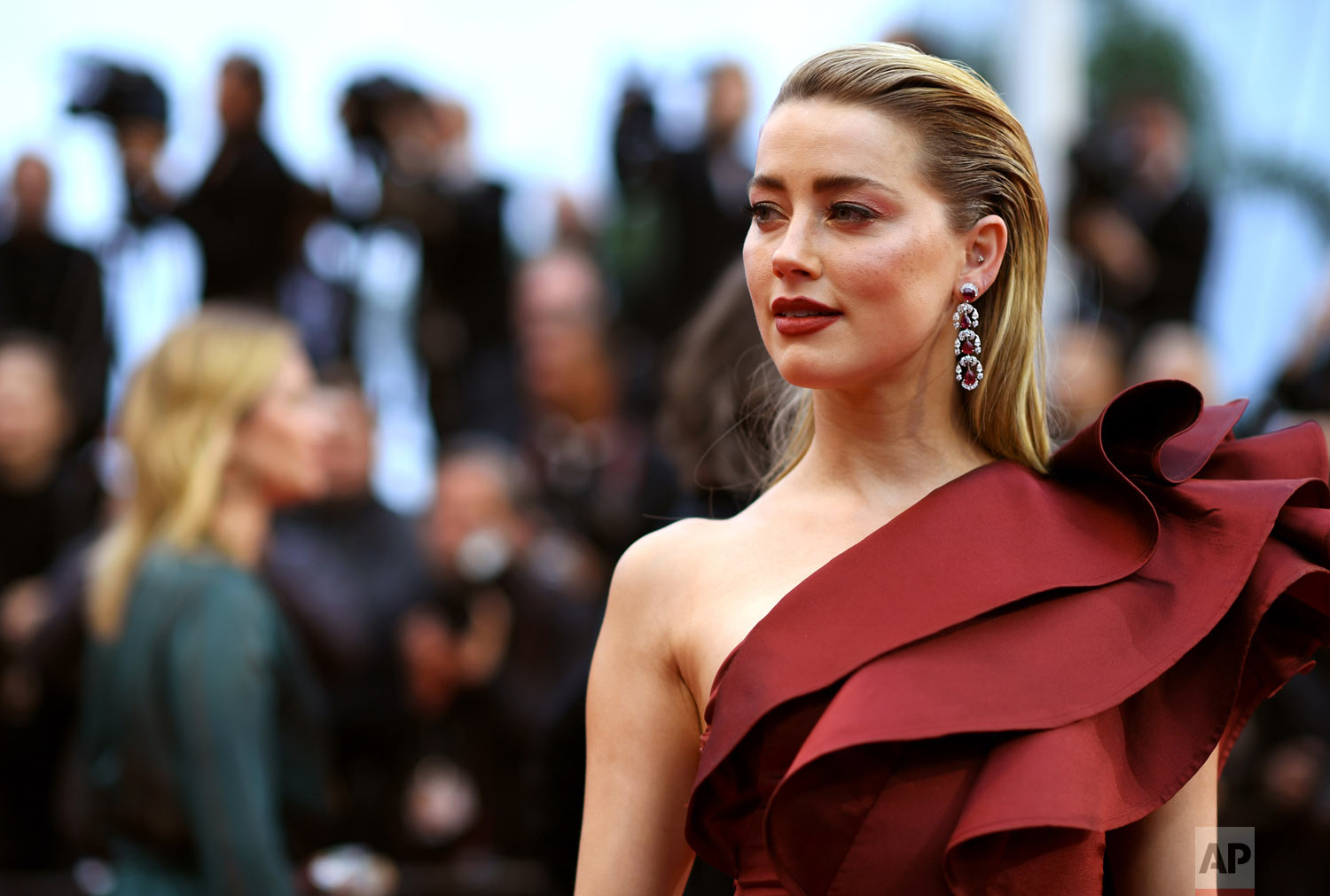 Actress Amber Heard poses at the 72nd international film festival, Cannes, France, May 17, 2019. (Photo by Arthur Mola/Invision/AP)