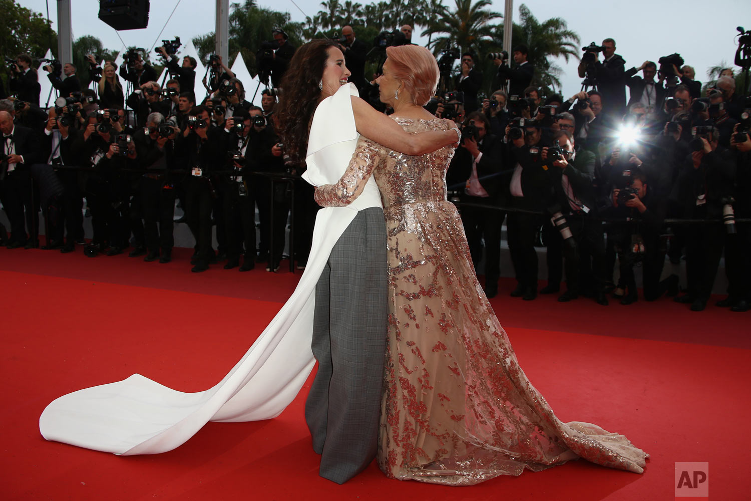 Actresses Andie MacDowell, left, and Helen Mirren pose for photographers upon arrival at the premiere of the film 'The Best Years of a Life' at the 72nd international film festival, Cannes, southern France, May 18, 2019. (Photo by Joel C Ryan/Invision/AP)