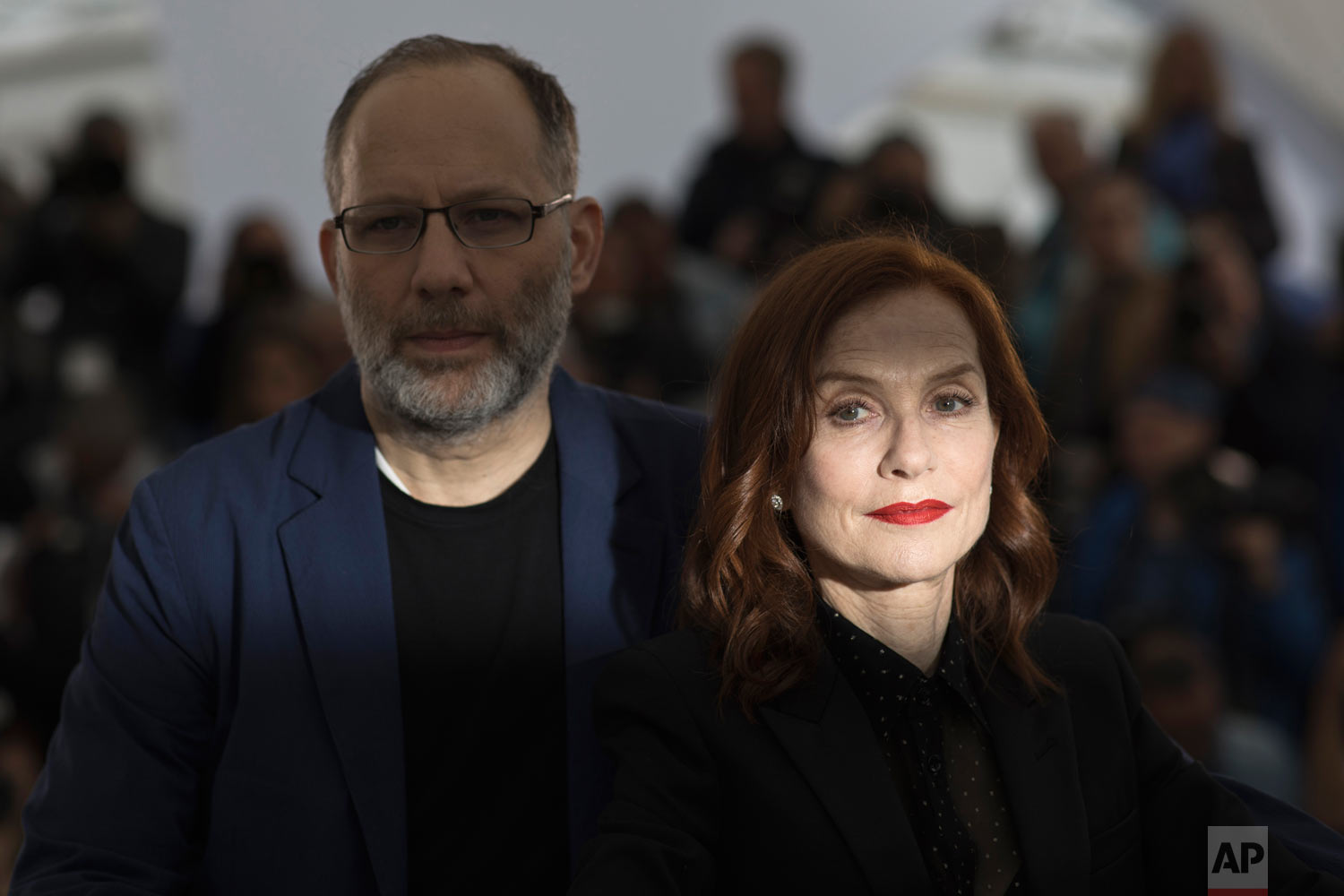 Director Ira Sachs, left, and actress Isabelle Huppert pose for photographers at the photo call for the film 'Frankie' at the 72nd international film festival, Cannes, southern France, May 21, 2019. (AP Photo/Petros Giannakouris)