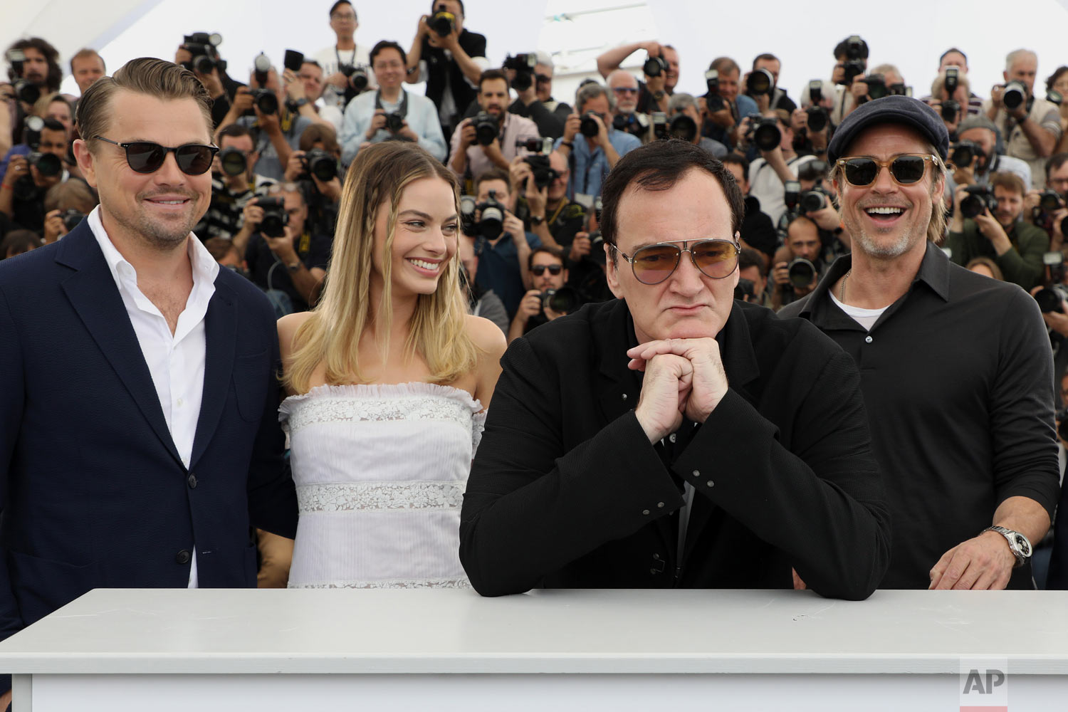 Actors Leonardo DiCaprio, from left, Margot Robbie, director Quentin Tarantino and actor Brad Pitt pose for photographers at the photo call for the film 'Once Upon a Time in Hollywood' at the 72nd international film festival, Cannes, southern France, May 22, 2019. (Photo by Vianney Le Caer/Invision/AP)