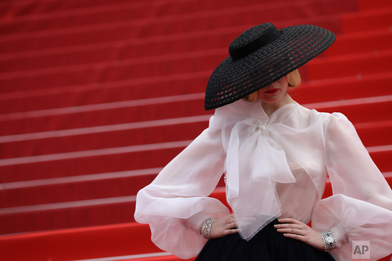 Jury member Elle Fanning poses for photographers at the premiere of the film 'Once Upon a Time in Hollywood' at the 72nd international film festival, Cannes, France, May 21, 2019. (Photo by Vianney Le Caer/Invision/AP)