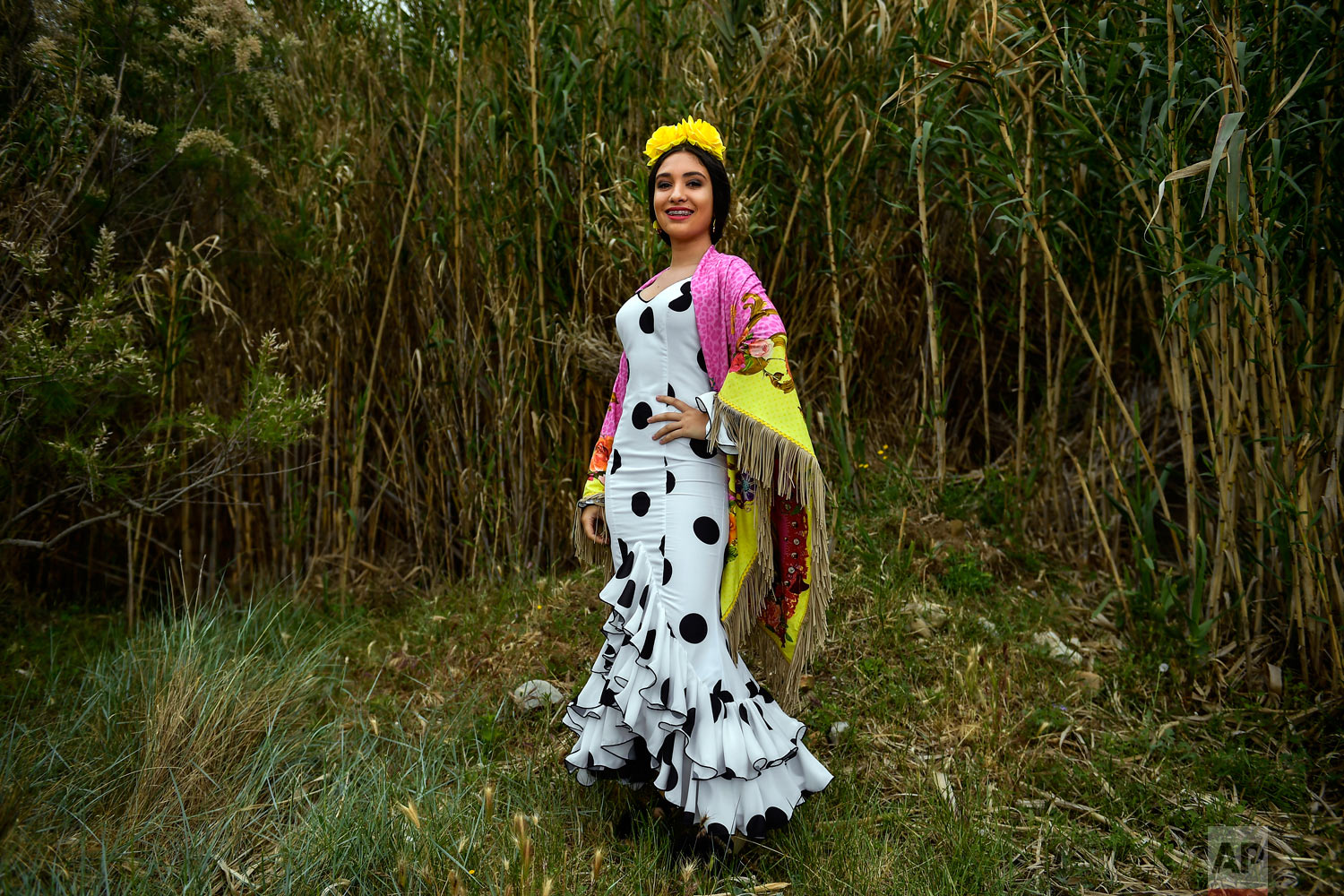 "Melena Garro, a devote of the Rocio Virgin, poses while taking part in the ""Romeria de El Rocio"" in the countryside outside Fitero, northern Spain, May 25, 2019. (AP Photo/Alvaro Barrientos)"