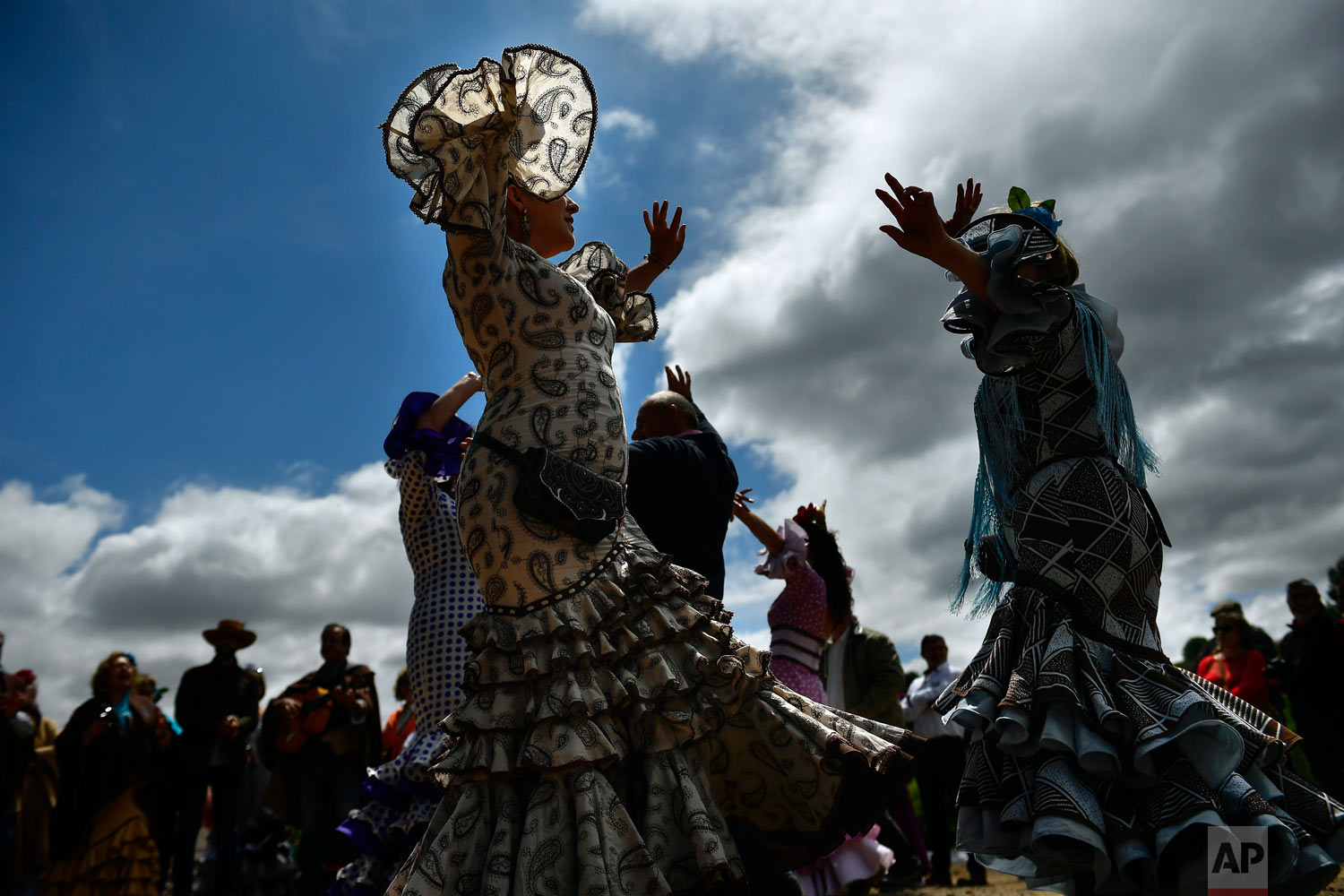 "Devotees of the Rocio Virgin dance while taking part in the ""Romeria de El Rocio"" in the countryside outside Fitero, northern Spain,, May 25, 2019. (AP Photo/Alvaro Barrientos)"