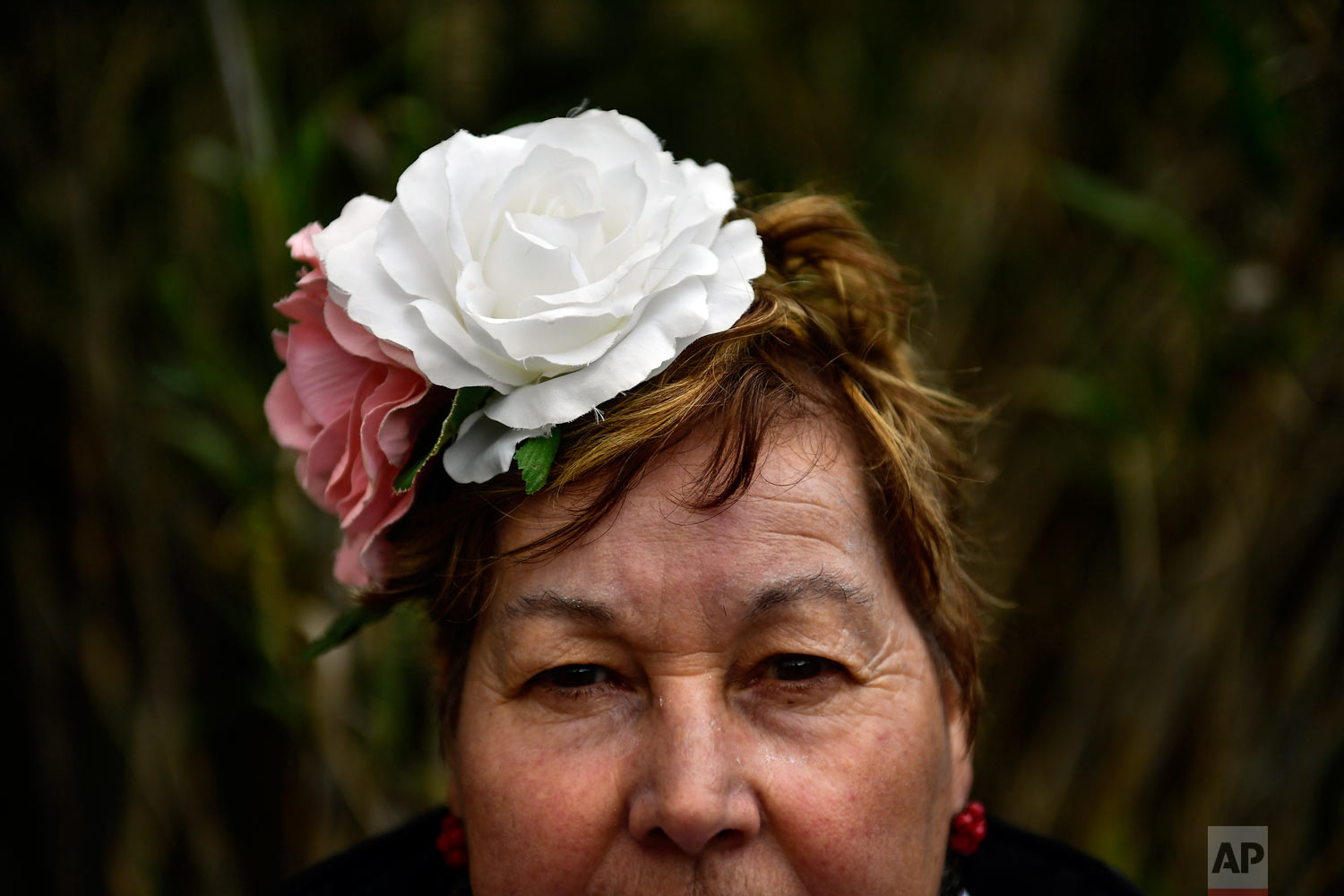 "Josefa Daza, a devote of the Rocio Virgin, poses while taking part in the ""Romeria de El Rocio"" in the countryside outside Fitero, northern Spain, May 25, 2019. (AP Photo/Alvaro Barrientos)"