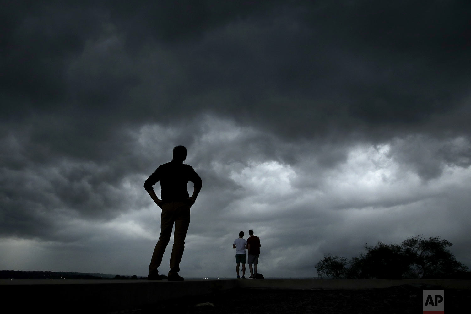 People watch from the Liberty Memorial as a severe storm that dropped several tornados earlier approaches downtown Kansas City, Mo., on Tuesday, May 28, 2019. (AP Photo/Charlie Riedel)