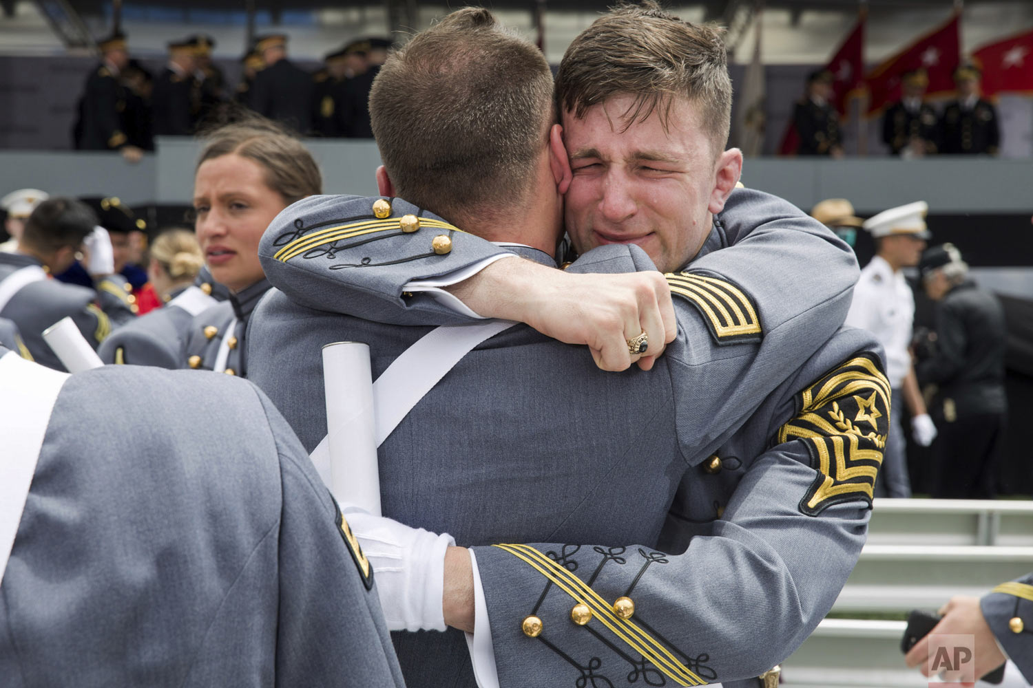 West Point cadets hug each other at the end of graduation ceremonies at the United States Military Academy in West Point, N.Y., on Saturday, May 25, 2019. (AP Photo/Julius Constantine Motal)