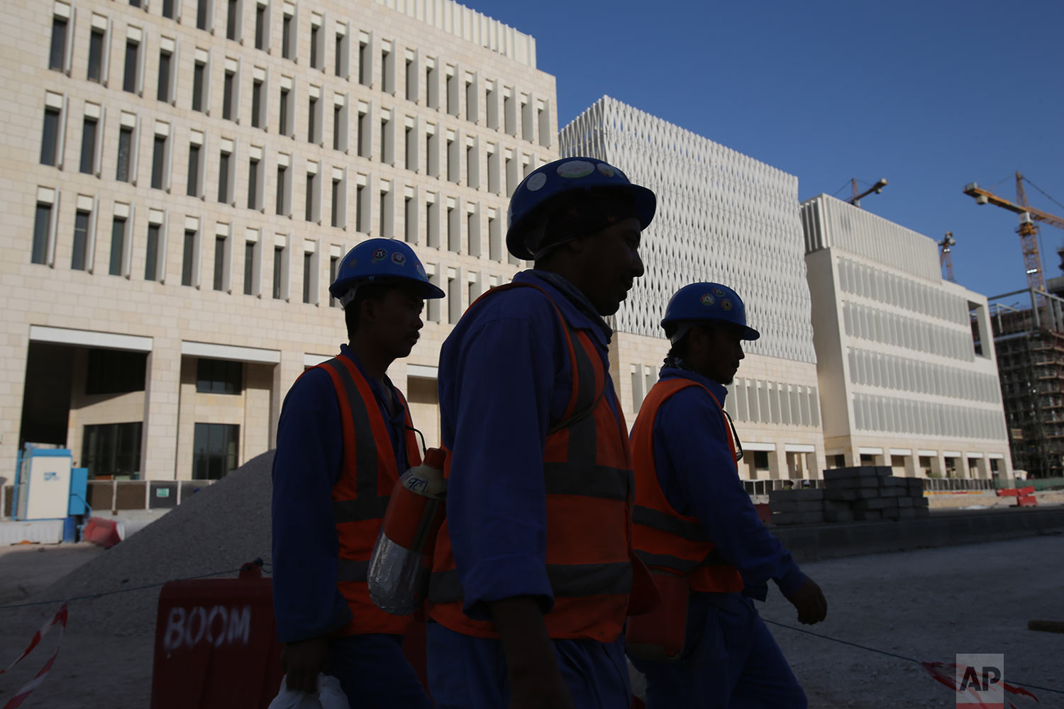 In this Tuesday, April 23, 2019 photo, labours leave their construction sites at the Msheireb Downtown Doha district in Doha, Qatar. (AP Photo/Kamran Jebreili)