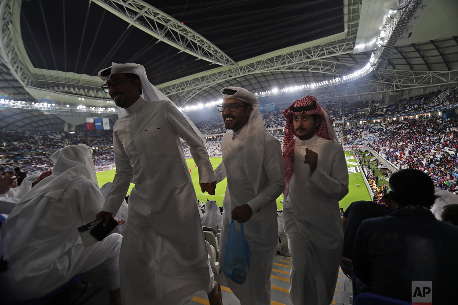 In this Thursday, May 16, 2019 photo, football fans leave their seats during the final match half-time at the inauguration ceremony of the Al Wakrah stadium in Doha, Qatar. (AP Photo/Kamran Jebreili)
