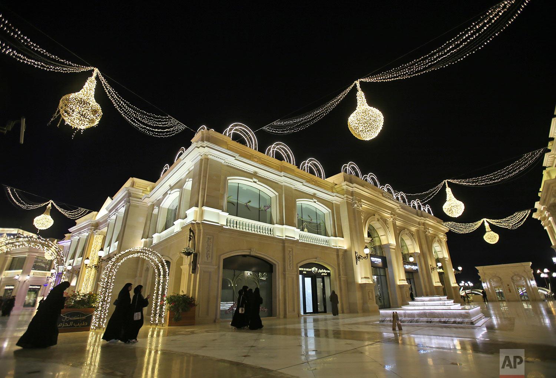 In this Wednesday, April 24, 2019 photo,  women walk at the Al Hazm luxury mall, in Doha, Qatar. (AP Photo/Kamran Jebreili)