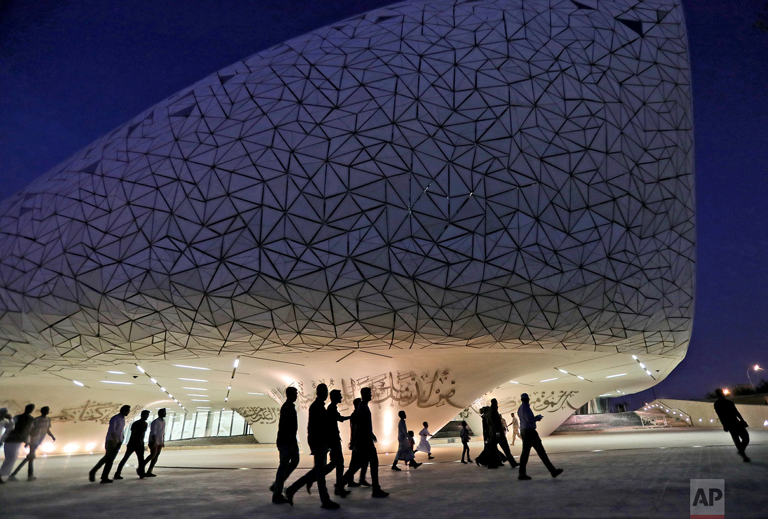 In this Sunday, May 12, 2019 photo, people leave the mosque to have their evening meal for Iftar during the holy month of Ramadan, at the Qatar Faculty of Islamic Studies in Doha, Qatar. (AP Photo/Kamran Jebreili)